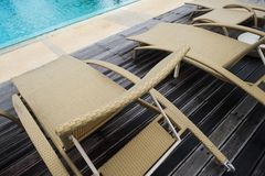 Sun chairs or loungers at the swimming pool. Place for ideal rest stock images