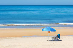 Sun chairs and umbrella on beach Royalty Free Stock Photos