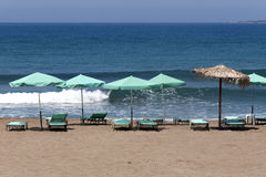 Sun chairs and umbrellas against Mediterranean Sea Royalty Free Stock Image