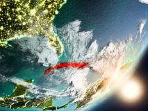Sun che aumenta sopra Cuba da spazio Immagine Stock Libera da Diritti