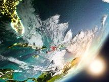 Sun che aumenta sopra Haiti da spazio Immagine Stock Libera da Diritti