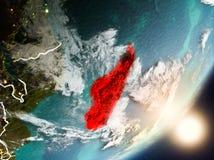 Sun che aumenta sopra il Madagascar da spazio Fotografie Stock