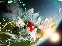Sun che aumenta sopra la Guyana da spazio Fotografia Stock
