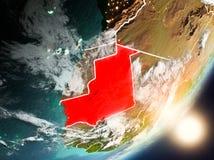 Sun che aumenta sopra la Mauritania da spazio Fotografie Stock