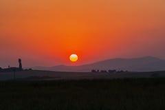 Sun che fissa i colori del paesaggio Fotografia Stock