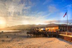 Sun che mette sul pilastro della spiaggia di Pismo Fotografie Stock