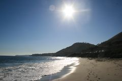Sun che trascura la spiaggia della costa ovest Immagini Stock Libere da Diritti
