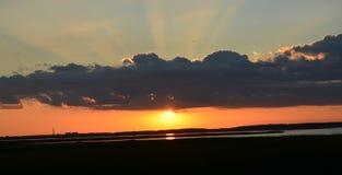 Sun che va giù Immagine Stock