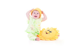 Sun child. Very happy baby with toys royalty free stock photography