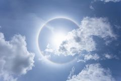 Sun with circular rainbow in day time royalty free stock images
