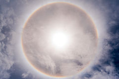 Sun with circular rainbow sun halo Royalty Free Stock Photos