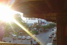 SUN & CITY. Sun over the city. Traffic in BANGKOK & x22;THAILAND& x22 Stock Photo