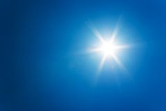 Sun at clear blue sky Royalty Free Stock Image