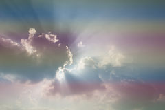 Sun and cloud background with a pastel colored  gradient. Royalty Free Stock Photos
