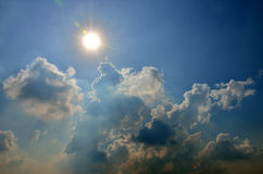 Sun and cloud in blue sky Stock Image
