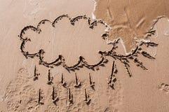 Sun and cloud drawing on beach sand. Sun with cloud drawing on beach sand Stock Image
