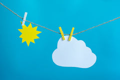 Sun and cloud. Hanging on a rope Royalty Free Stock Image