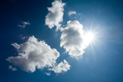 Sun through clouds Stock Photography