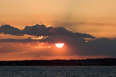 Sun in clouds. Sun and clouds in the bay Stock Photography