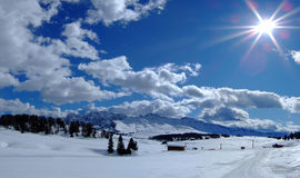 Sun and clouds. Winter walking in val gardena Royalty Free Stock Photography