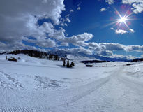 Sun and clouds. Winter walking in val gardena Stock Photo