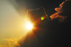 Sun through clouds. Sunshine rays through clouds, waiting for storm Royalty Free Stock Image