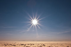 SUN AND CLOUDS. Early morning sun above thick clouds Stock Images