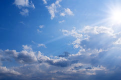 Sun and clouds. Against blue sky Royalty Free Stock Photos