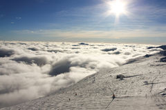 Sun and clouds above Jasna slopes. Amazing atmosphere on Jasna slopes as seen from Rotunda, Chopok Mountain stock photo