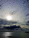 Sun with clouds arranged in pattern mauritius stock photography