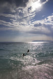 Sun and clouds on a beach. In Tucepi, Croatia, Adriatic sea Stock Photography