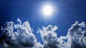 Sun and clouds Stock Image