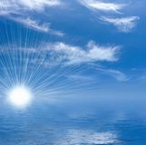 Sun and clouds on blue sky Stock Photography