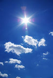 Sun and clouds in blue sky Royalty Free Stock Photos