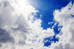 Sun in clouds on blue sky Royalty Free Stock Photos