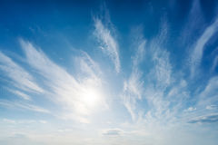 Sun and clouds in blue sky Royalty Free Stock Photo