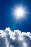 Sun and clouds in dark blue sky. Vertical image can be used as a background and in different other projects Royalty Free Stock Photo