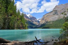 Sun and Clouds at Glacial Kinney Lake, Mount Robson Provincial Park, British Columbia. Turquoise glacial waters of the Robson River colour the beautiful Kinney stock image