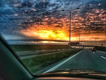 Sun and clouds on highway Royalty Free Stock Photos