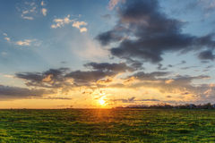 Sun and clouds Stock Photos