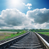 Sun with clouds and railroad Stock Photography