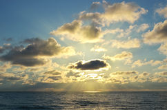 Sun and clouds on sea. Royalty Free Stock Images