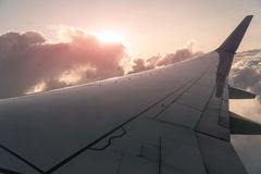 Sun and Clouds and sky as seen through window of an aircraft Stock Images