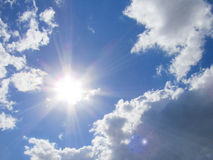 Sun and clouds. Sun, clouds and sky. Solar rays falling on the clouds giving special effect Stock Photography