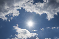 Sun with clouds. And some clouds royalty free stock image