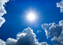 Sun and Clouds. Summer Sky Cloudscape Area with the Sun Stock Photography