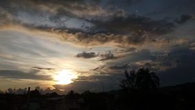 Sun between clouds. Sunset between the clouds Royalty Free Stock Photography