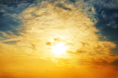 Sun and clouds in sunset Royalty Free Stock Photo