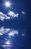 Sun clouds and water Royalty Free Stock Images