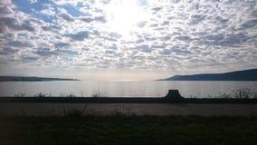 Sun and clouds. Water Van golu Royalty Free Stock Photos